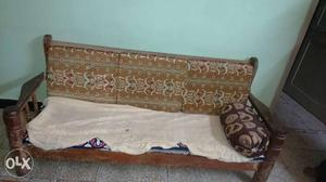Brown Wooden Farmed White And Brown Cushion Couch