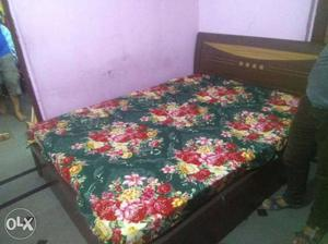Good condition bed with mattress dual sided used