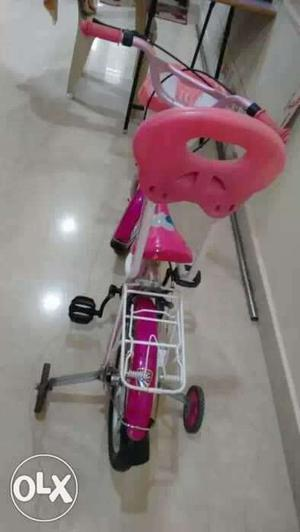 Toddler's Pink Framed Bicycle With Training Wheels