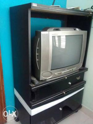 Samsung box TV, remote and a TV stand..