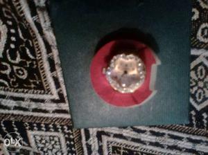 Ladies ring golden watch with diamonds