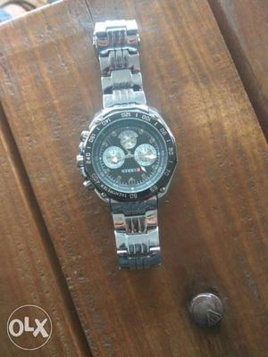 Round Black Curren Chronograph Watch With Silver Link Band