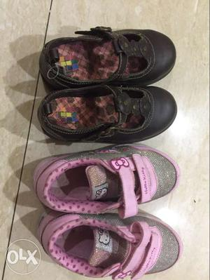 Toddler's Two Pairs Of Pink And Black Shoes
