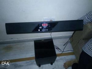 Black Soundbar And Multimedia Speaker