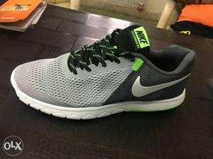 Paired Gray And Black Nike Running Shoe