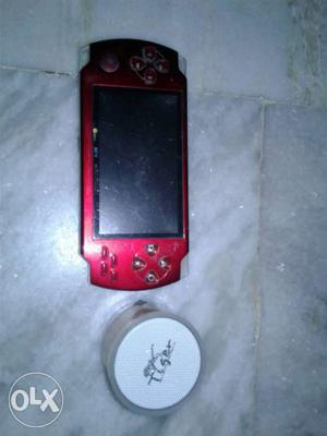 Red psp with memory attachment and bluetooth