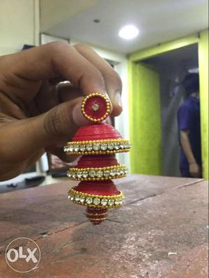 Pair Of Gold, Red And Diamond Thread Jhumka Earrings