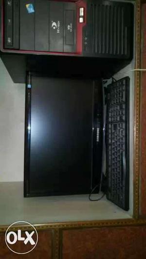 Black Samsung Led Monitor; Computer Keyboard And Computer