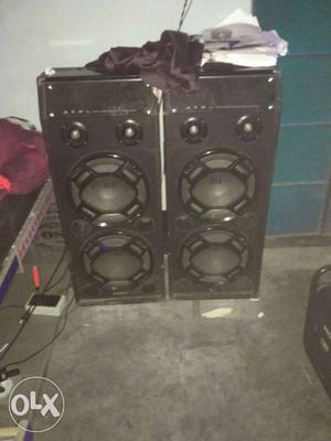 Two Black Tower Speakers