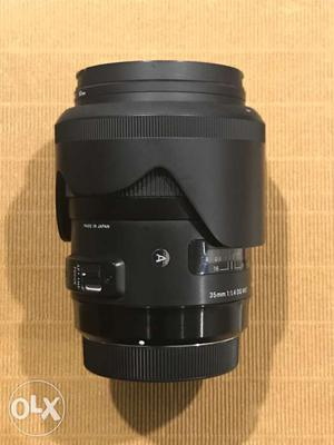 Sigma Art 35mm F1.4 lens with box, hood and Hoya UV - Mint