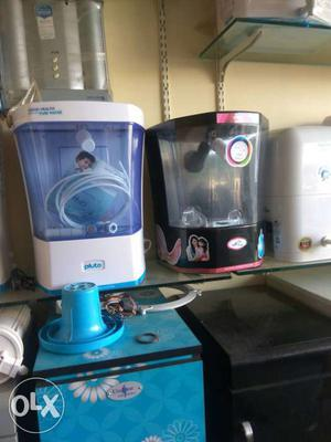 Three Black, White, And Grey Water Purifiers