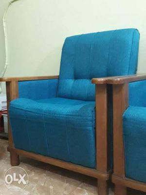 Blue Cushioned Brown Wooden Frame Armchair