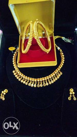 Gold Necklace And Hoop Earrings In Box