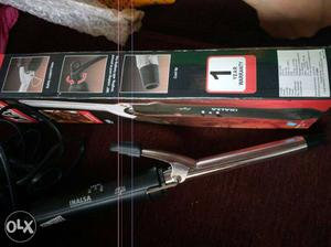 Hair curler and hair straighter...brand