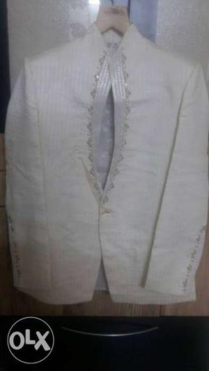 Off white 2 piece Men's suit with embroidery on