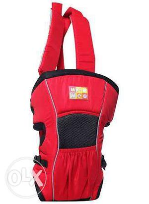 Red color baby carrier with box