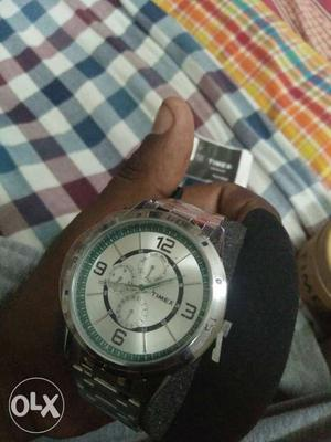 Round Silver Timex Chronograph Watch With Silver Link Band