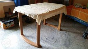 Rectangular Brown Wooden Table With White Table Cloth