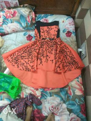 Orange And Black Floral Sleeveless Flare Mini Dress
