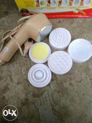 White And Brown Face Massager