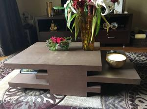 Rectangular brown wooden coffee table in a very
