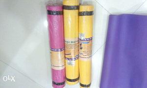 Three Yellow And Pink Yoga Mat