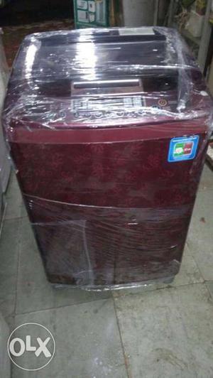 Maroon And Black Top Load Washing Machine