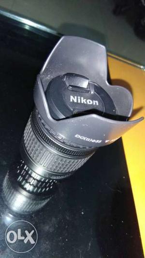 Nikon  mm DX vr new nikkor lens with hood.