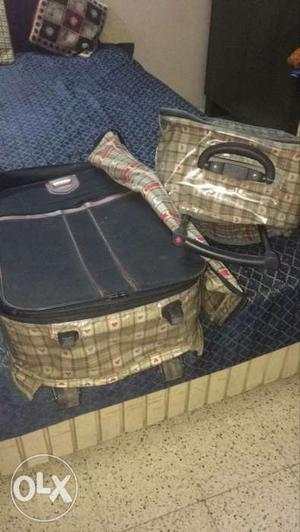 Set of two suit case with troly and cover