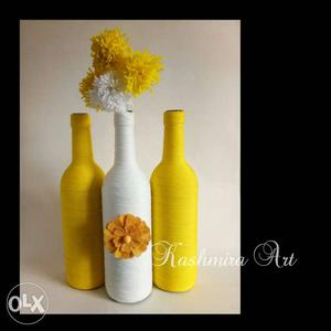 Two yellow and one white bottle combination with