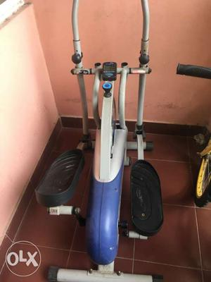 Gray And Blue Elliptical Trainer in good condition