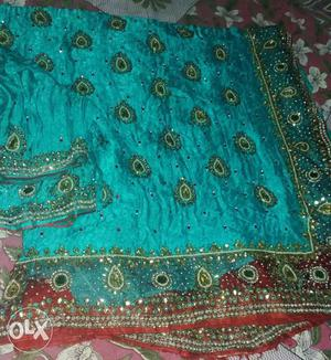 Heavy work saree just used only once.