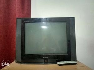 Black Sansui CRT TV and TV table