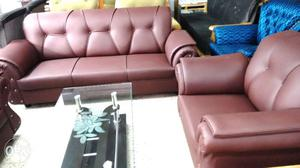 A cherry new leatherette sofa set in 3+1+1
