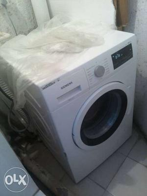 Brand new Siemens Front load Touchscreen washing