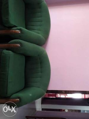 It is a single seater sofa.It is made of teak