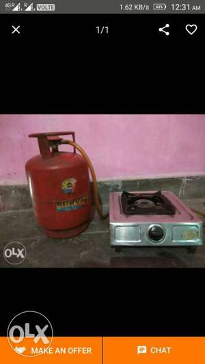 Red Propane Tank With Stainless Steel Gas Cooktop