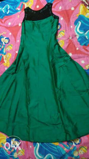 Beautiful party wear green padded gown with black net on