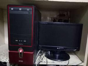 LG Flat Screen Computer Monitor And Black And Red Computer
