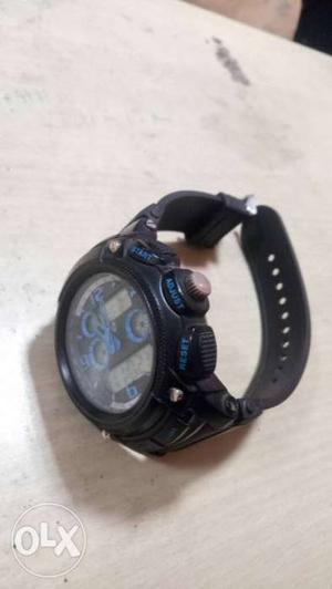 Round Black Framed Black Chronograph Watch With Black Strap