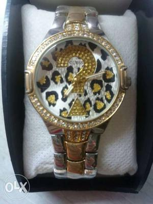 Gold and silver Guess watch