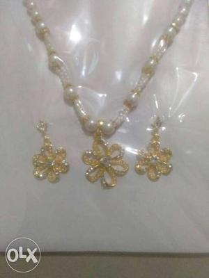 Silver And Gold Colored Necklace And Pair Of Earrings Set