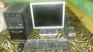 Grey Flat Screen Computer, Mouse And Keyboard, And, UPS