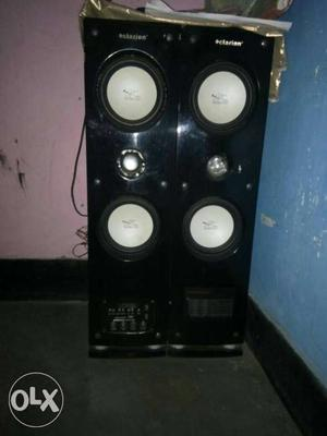 Two Black-and-white Tower Speakers
