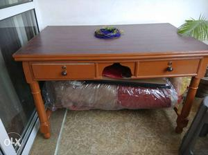 A sheesam wood table in a very good condition