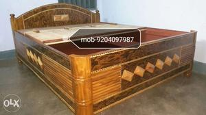 A wooden double bed having size 5/6.5 made of