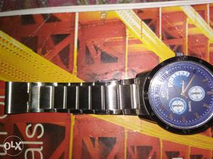 Round Blue Chronograph Watch With Silver Linked Band