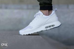 Unpaired White Nike Athletic Shoe