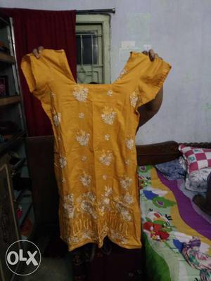 Nice short kurti for girls colour yellow