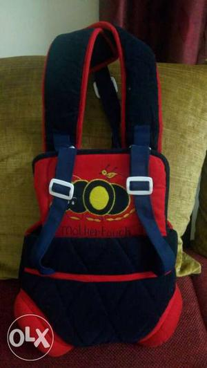 Mother touch baby carry bag